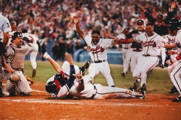 921014 Atlanta - Sid Bream , prone on the ground, gets mobbed by teammates after scoring the winning run in the bottom of the 9th inning of Game 7 of the 1992 NLCS vs the Pittsburg Pirates, giving the Braves the NL Championship. The lumbering Bream scored from 2nd on a Cabrera single to end the game. (AJC Staff/FRANK NIEMEIR)