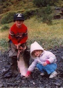 My dad hooked this King Salmon on his birthday and let me reel it in sometime around 1987. That's my sister, Tina, helping me out with it.